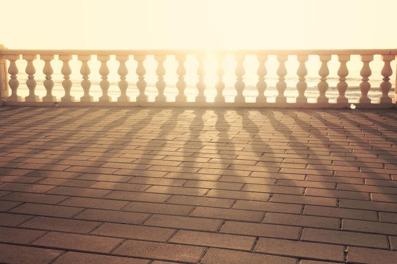 Falling again Backlit No People Outdoor Pavement Promenade Railings Sea Shadow Shadows & Lights Sidewalk Sunset