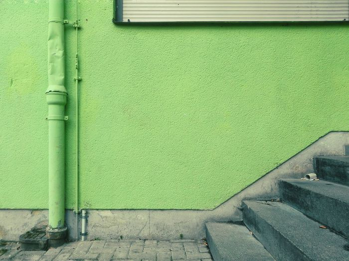 Steps Against Green Wall