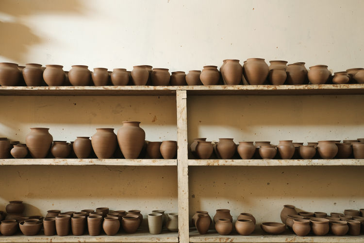 Close-Up Of Pottery In Shelves