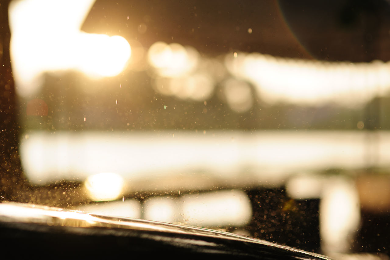 transportation, window, lens flare, drop, wet, water, no people, land vehicle, car, windshield, mode of transport, reflection, raindrop, road, nature, car interior, illuminated, night, journey, close-up, defocused, indoors, beauty in nature, sky
