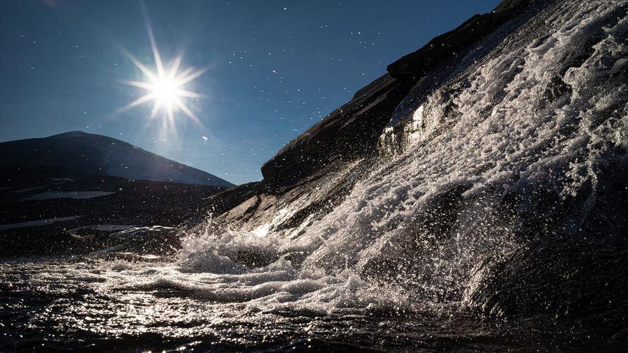 Water splashing in sky on sunny day
