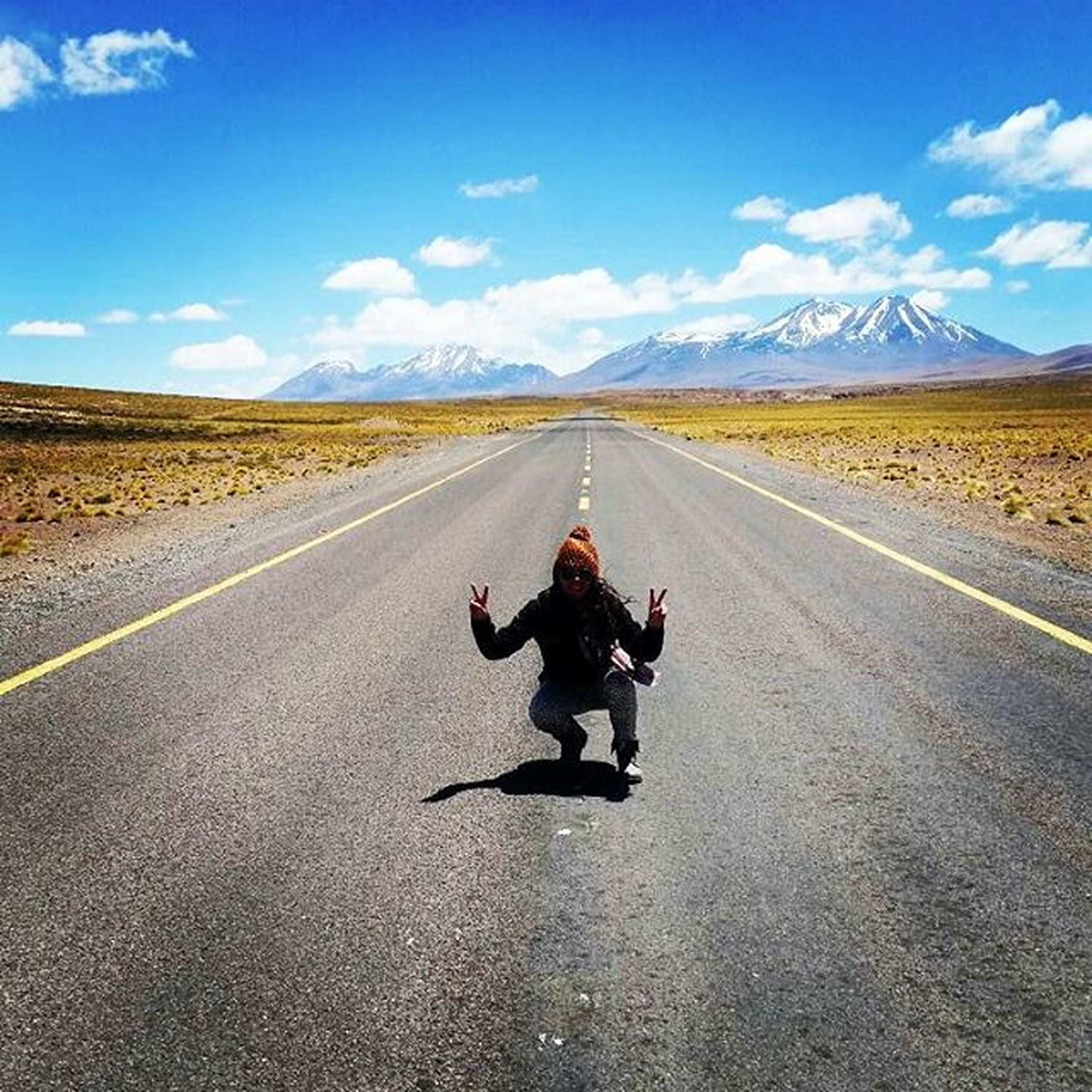 the way forward, transportation, road, vanishing point, diminishing perspective, sky, road marking, asphalt, rear view, landscape, full length, country road, dog, walking, cloud, street, cloud - sky, lifestyles
