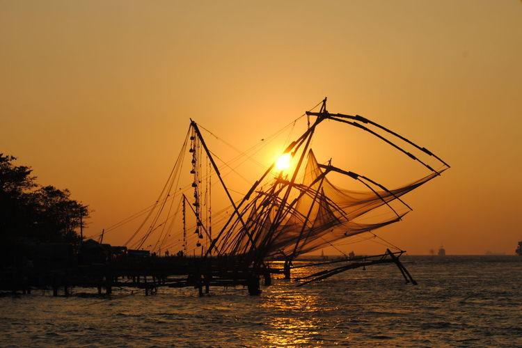 Beauty In Nature Chinese Fishing Nets Fort Kochi Idyllic Kerala Nature No People Non-urban Scene Orange Color Outdoors Remote Rippled Scenics Sky Sun Sunbeam Sunlight Sunset Tranquil Scene Tranquility Water