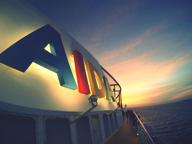 AIDA EyeEmNewHere Water Sea No People Illuminated Sky Direction Communication Sunset Guidance Pacific Ocean Aida EyeEmNewHere EyeEm Ready   AI Now