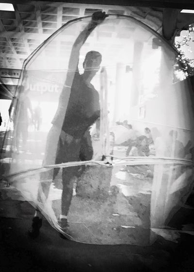 Street Photography Streetphoto_bw Monochrome Walking Standing Person Front View City Life Snap Blackandwhite Screen Tent Decisive Moment Blocking My Way Light And Dark Tunnel Weekend Activities Blurry Circle Eye4photography  Urban Lifestyle l Snapshots Of Life Monochrome Photography