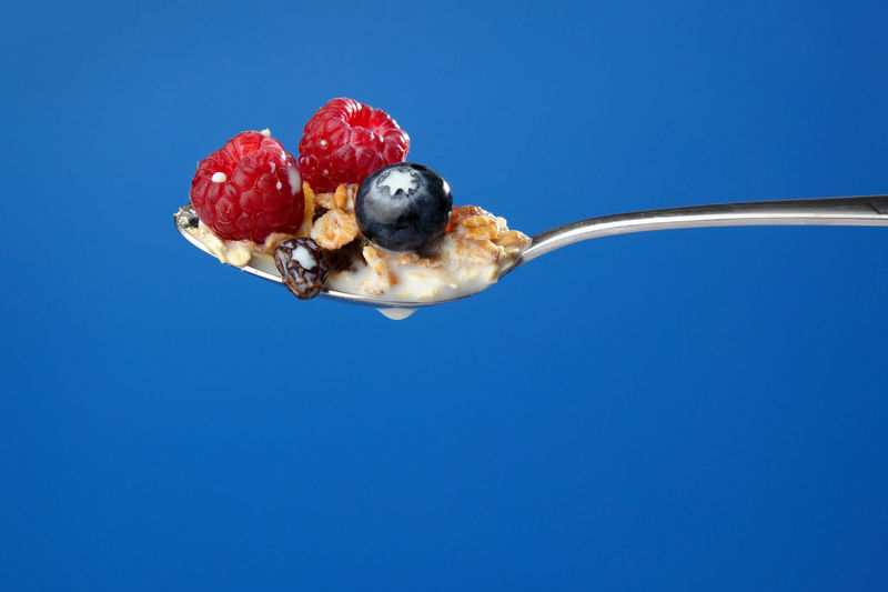 Close-up of strawberry against blue background