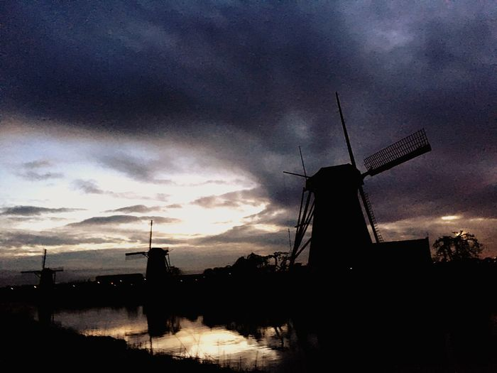 Kinderdijk Mills Environmental Conservation Wind Power Sky Fuel And Power Generation Alternative Energy Wind Turbine Windmill Renewable Energy Cloud - Sky Nature Built Structure No People Silhouette Water Beauty In Nature Outdoors Low Angle View Architecture Technology Day