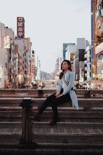 Urban Holiday Japan OSAKA Architecture One Person City Adult Young Adult Lifestyles Building Exterior City Life Women Beauty Young Women Emotion Beautiful People Built Structure Happiness Full Length Smiling Modern Communication Positive Emotion