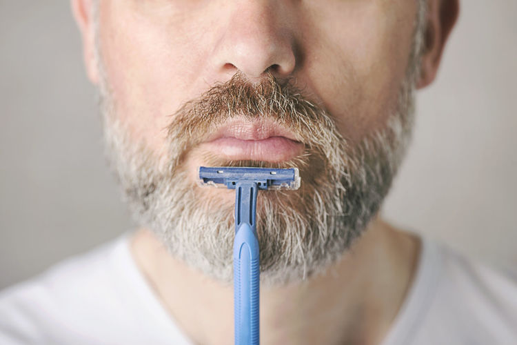 Beard Facial Hair Adult Males  Men Mature Adult Human Body Part Close-up Portrait Human Face Shaving Shaved Head Care Hygiene Hygiene Concept Routine Lifestyle Mustache Expression Razor Facial Hair Facial Skin Skin Care Adult Treatment Cleaning Morning Male People Healthy Healthy Lifestyle Face Sharp Blade Masculinity Mature Man Concept Cut