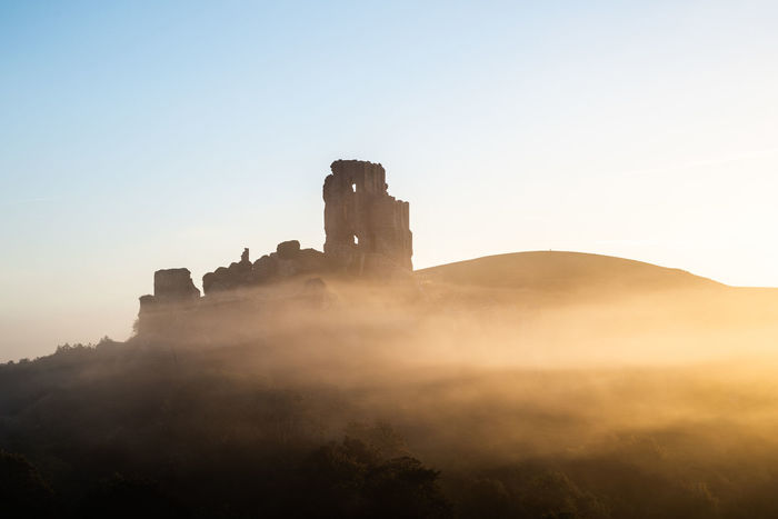corfe castle in the early morning mist at sunrise Copy Space Dorset EyeEm Best Shots Tourist Attraction  Ancient Ancient Civilization Architecture Building Building Exterior Built Structure Castle Clear Sky Copy Space Corfe Castle Day History Mist Misty Morning Nature No People Old Old Ruin Outdoors Places To Visit Places You Must To See Ruined Sky Sunlight Sunrise The Past Tourist Destination Travel