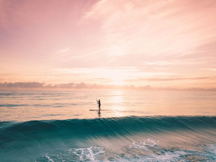 Sea Sunset Scenics Water Beauty In Nature Nature Sky Tranquility Outdoors One Person Horizon Over Water Beach Wave Vacations People Day Real People