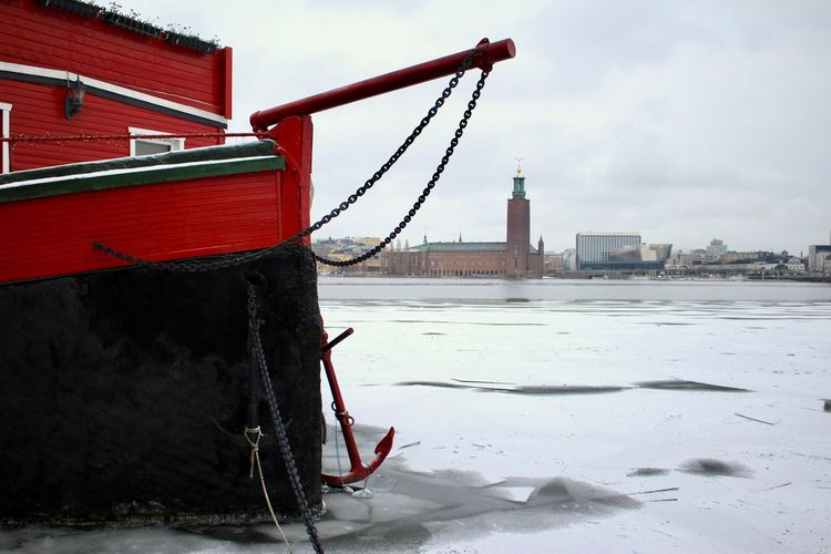 Söder Mälarstrand, Stockholm Sweden TOWNSCAPE Wintertime Anchor Architecture Boat Building Exterior Built Structure City Cityscape Cold Temperature Cold Winter Day Day Frozen Nature Nautical Vessel No People Outdoors Red Sky Snow Water Water_collection Waterfront Weather Winter