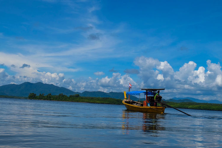 Muslim Fisherman in Pangnga bay Nautical Vessel Cloud - Sky Lake Tourism Outdoors Mountain Travel Sky Water Transportation Travel Destinations Landscape Nature Adult Day People One Person Backgrounds Pangnga Muslim Fisherman Fishing Time Fisherman Boat Fishing Boat Fishing Village