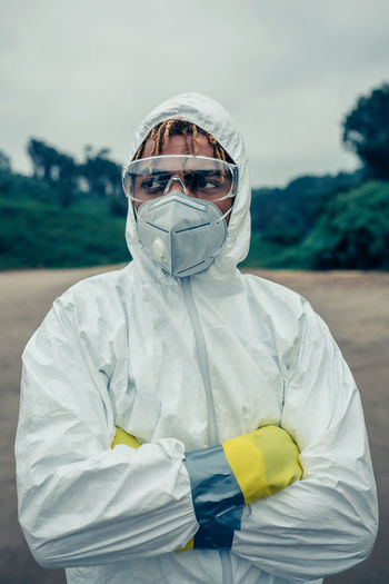 Scientist wearing protective workwear standing outdoors