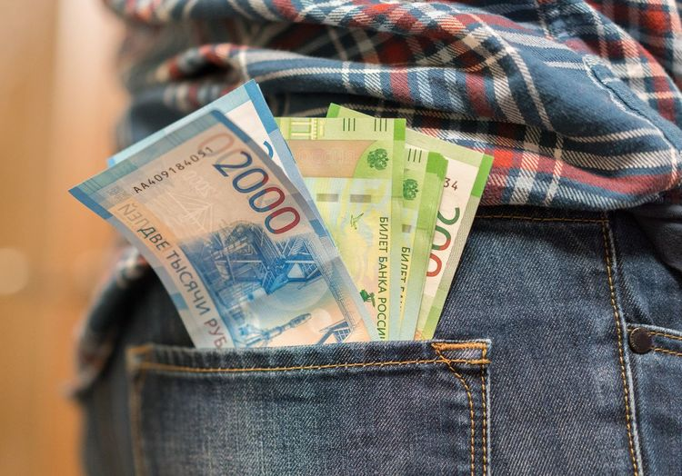 Midsection of man with paper currencies in back pocket