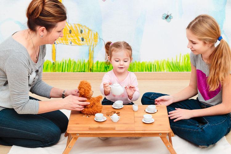 Family Having Baby Tea Party