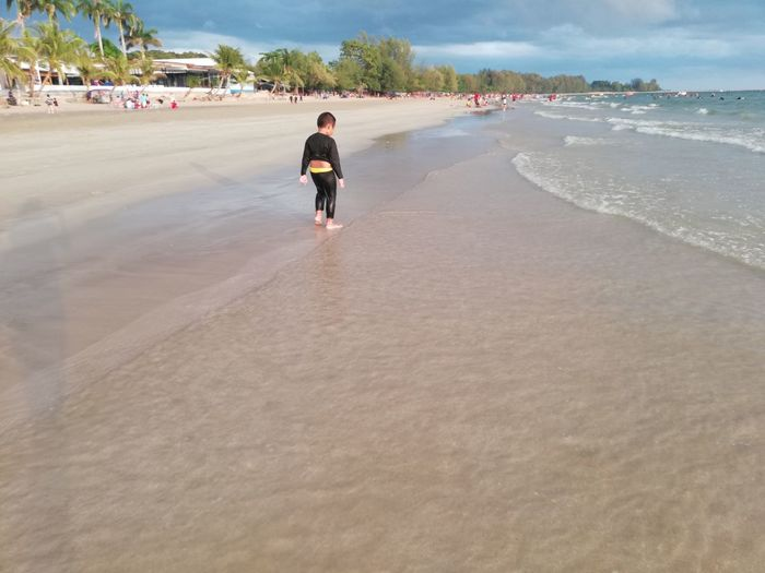 Children enjoy on summer trip 2019,หาดเจ้าหลาว Achi2019 One Person Sand Beach Full Length Sea Land Rear View Water Walking Lifestyles Real People Leisure Activity Nature Day Sky Holiday Motion Incidental People Outdoors