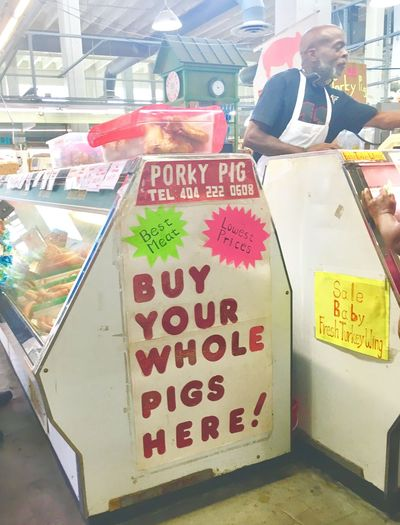 Piggies Chance Encounters Selling Whole Pig Signage Man Selling Food Market Check This Out Indoor Photography