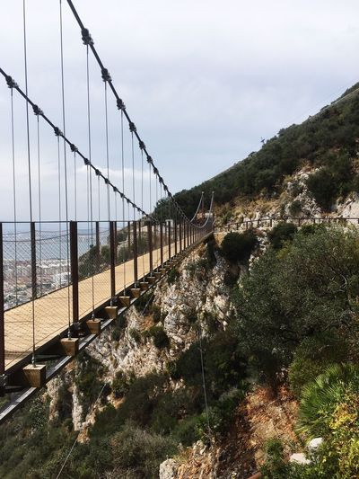 Bridge - Man Made Structure Connection Water Sky Outdoors Suspension Bridge Nature Scenics Mountain Travel Destinations