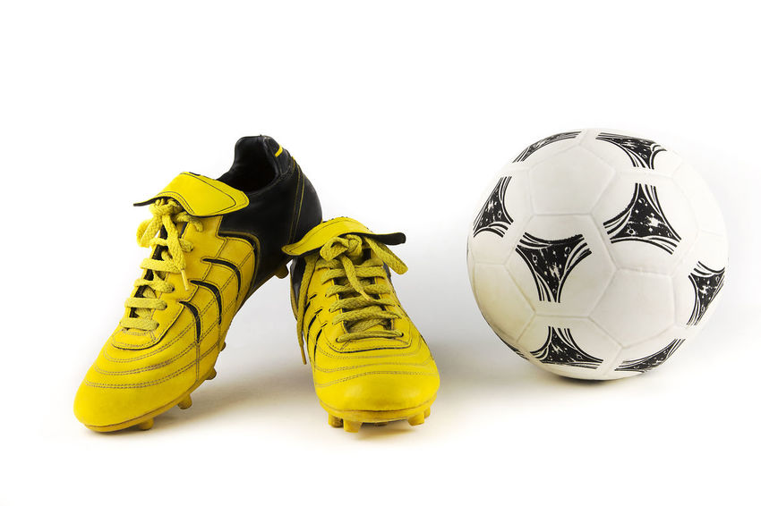 Ball Black Color Cleats Close-up Cut Out Football Multi Colored No People Outdoors Rubber Soccer, Still Life Studio Shot Two Objects White Background Yellow