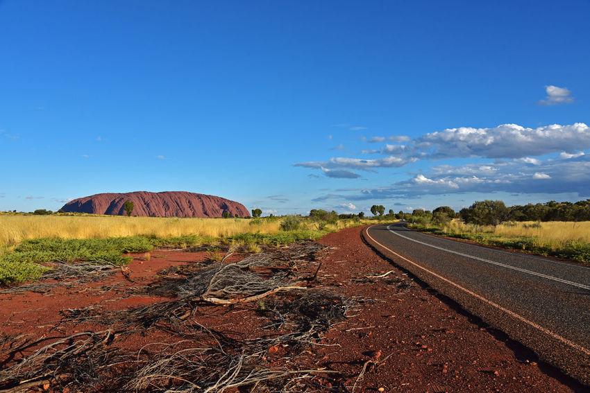 The road to Uluṟu-Kata Tjuṯa National Park in Australia Australia Desert Northern Territory Outback Road Rock Formation Uluru Beauty In Nature Landscape Outdoors