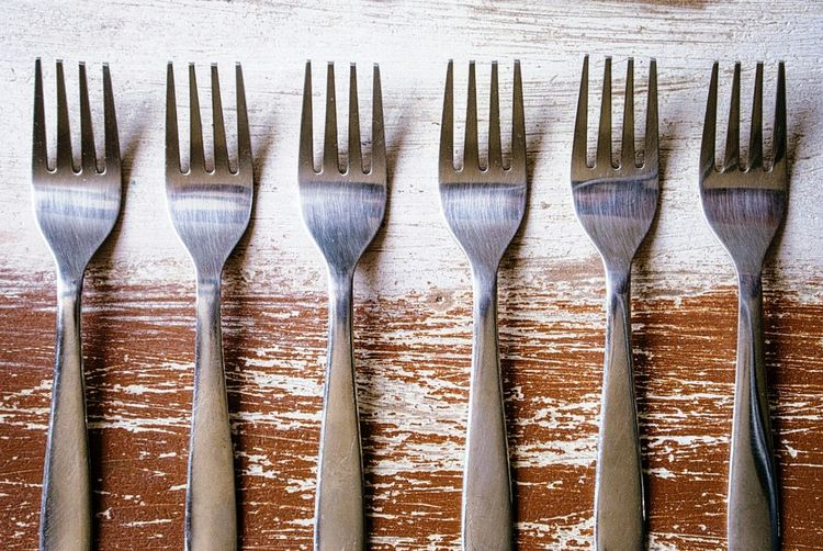 High Angle View Of Forks On Wooden Table