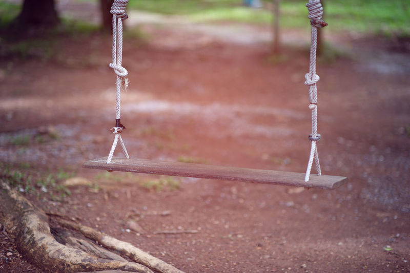 Close-up of swing at playground