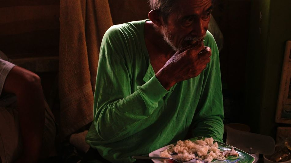 Old man having his meal after a long and heavy work. Meal Warm Artex MALABON Artex Compound Philippines Landscape Portrait Of A Man  Life Men This Is Masculinity