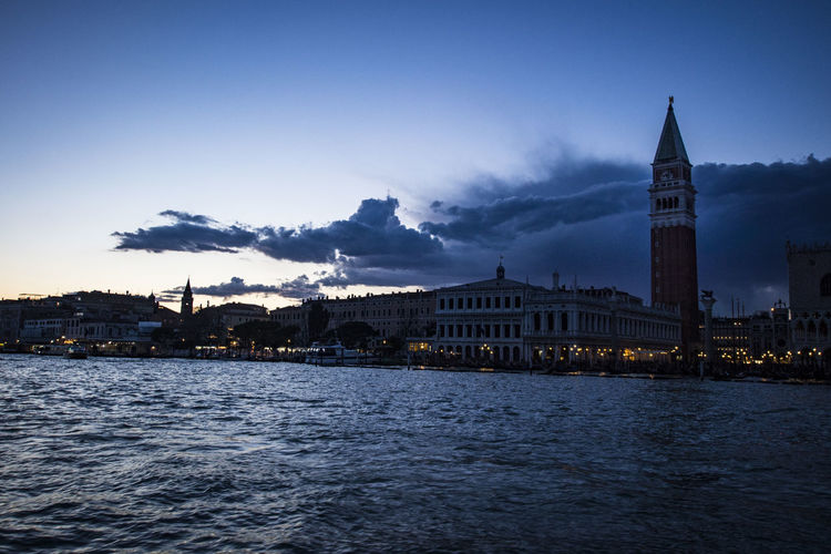 Doges Palace - Venice And St Marks Square By San Marco Canal Against Sky During Sunset