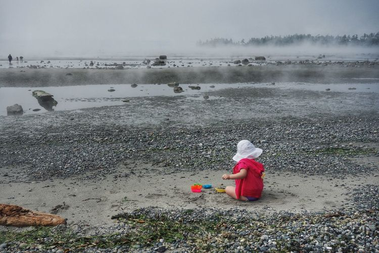 playing on the beach. Family Fun Searching Rocks Nature Beach Child Child Playing Rocky Beach San Juan Islands Washington State False Bay Playing In The Sand Sand Distant Horizon Youth Color Of Life Colour Of Life