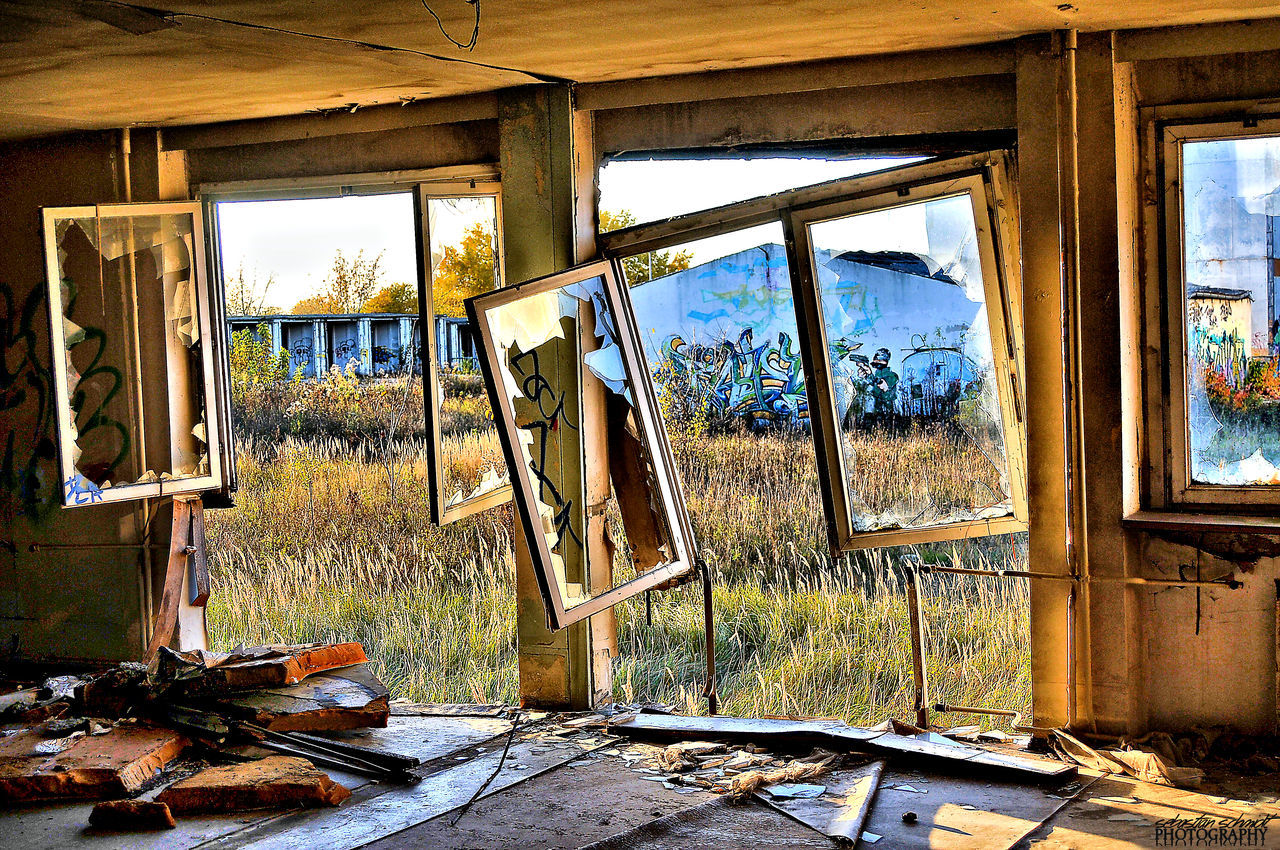 window, abandoned, damaged, indoors, day, destruction, weathered, bad condition, run-down, no people, architecture, sky, tree