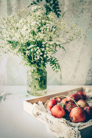 Red apples and field flowers Field Flowers Rustic Apples Close-up Day Flower Flower Arrangement Flowering Plant Focus On Foreground Food Food And Drink Freshness Fruit Healthy Eating Indoors  Lifestyles Nature No People Plant Red Ripe Still Life Table Wellbeing The Still Life Photographer - 2018 EyeEm Awards