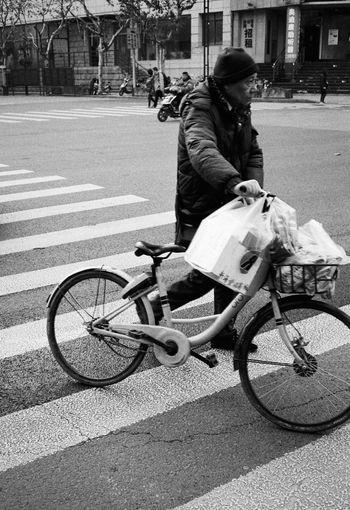 Transportation Real People Bicycle City Mode Of Transportation Land Vehicle Street One Person Full Length Day Road Ride Men Lifestyles Incidental People Casual Clothing Riding Sunlight Leisure Activity Outdoors Streetphotography Film Photography Blackandwhite
