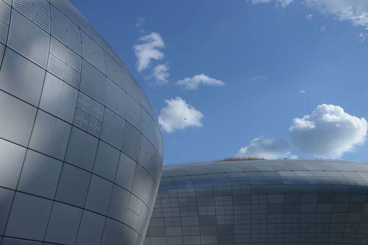 Sky Architecture Cloud - Sky Building Exterior Built Structure Day Nature Modern Outdoors No People Building Low Angle View Industry Blue City Office Building Exterior Glass - Material Factory Tall - High Sunlight Silver Colored