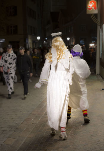 Angel Angels Blond Hair Carnival Carnival Crowds And Details Darkness And Light Light Light And Shadow Night People People Photography People Watching Street Streetphotography Walking