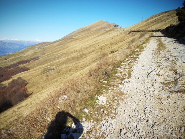 Clear Sky Dirt Road Human Shadow Landscape_photography Mountain Outdoors Path Personal Perspective Remote Solitude Sunny The Way Forward To The Top Live For The Story Be. Ready. An Eye For Travel