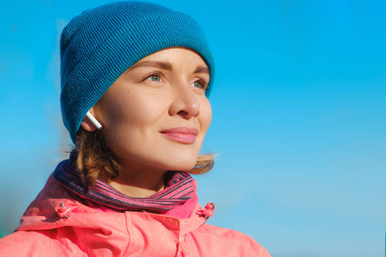 Close up of a beautiful caucasian young woman listening to music on earphones while doing work out outdoors in sunny winter Blue Headshot One Person Portrait Close-up Leisure Activity Real People Lifestyles Sportsman Sports Clothing Earphones Earpods Technology I Can't Live Without Fitness Training Good Vibes Good Weather Happy People Women Females Femininity Women Who Inspire You women around the world Women Of EyeEm
