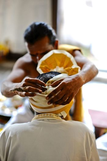 Indian Wedding Close-up Day Focus On Foreground Food Freshness Help Human Hand Indian Priest Indoors  Men Occupation One Person People Preparation  Real People