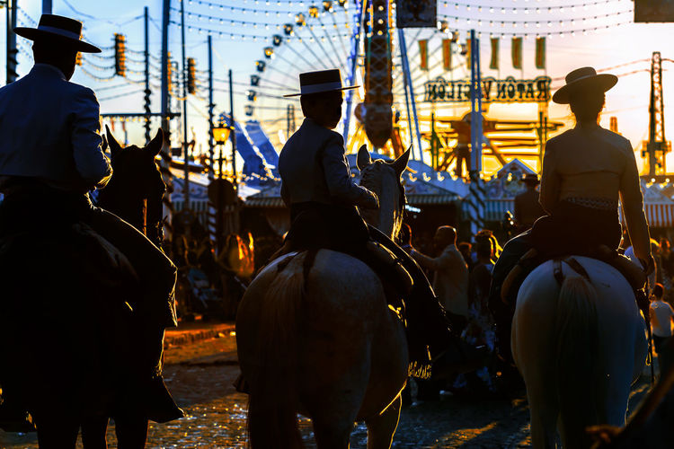 Silhouette of Horse riders at sunset. Spanish Culture Andalusia Andalusian April Beautiful Cultures Dance Dress Fashion Feria De Abril Flamenco Folklore Horse People Sevilla Seville SPAIN Spring Style Sunset Traditional Traditional Clothing Traditional Culture Traditional Festival Woman Day Women