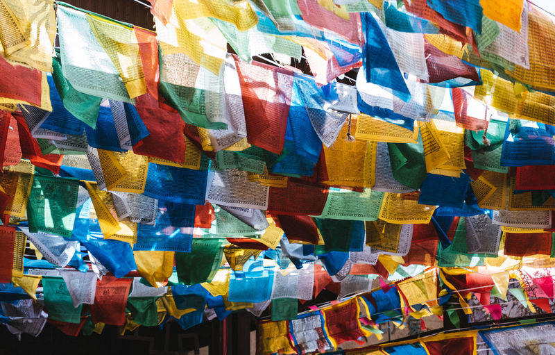 Full frame shot of multi colored prayer flags hanging outdoors