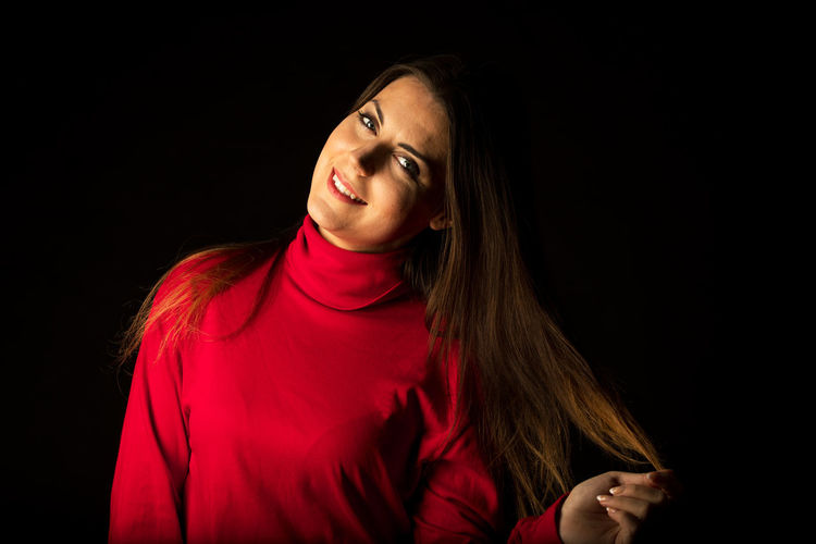 Black Background Studio Shot Red One Person Indoors  Hair Long Hair Women Young Adult Portrait Adult Smiling Headshot Hairstyle Looking Clothing Front View Young Women Emotion Beautiful Woman Contemplation Straight Hair