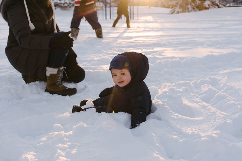 Having fun in the snow Baby Boy Carefree Cheerful Child Childhood Cold Temperature Enjoyment Fun Happiness Holidays Leisure Activity Outdoors Season  Smiling Snow Toddler  Vacations Warm Clothing Winter