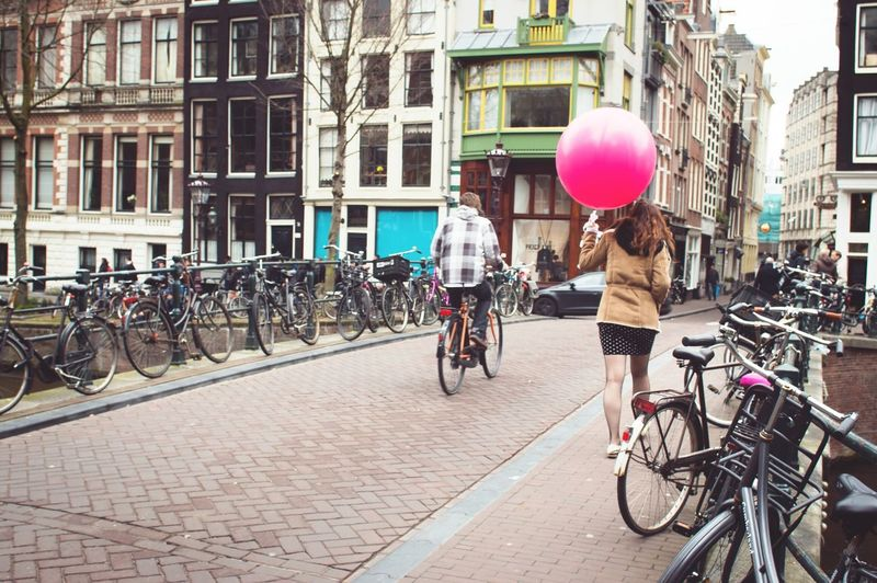 Traum von Amsterdam 👌 Here Belongs To Me Amsterdam Europe City Urban Bikes Woman Individuality Bridge Buildings Culture Baloon Pink Vintagelens Tokina Sony Showcase April Photography In Motion Your Amsterdam Up Close Street Photography Telling Stories Differently The Street Photographer - 2016 EyeEm Awards Found On The Roll