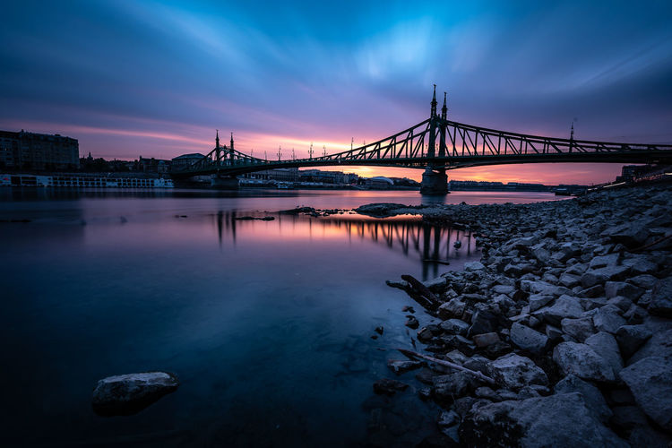 Copy Space Architecture Reflection River Water Nature City Urban Morning Sunrise Sky Bridge Morning Light Dawn Outdoors Rock Purple Cityscape Connection No People Cloud - Sky Built Structure Rock - Object Transportation Bridge - Man Made Structure