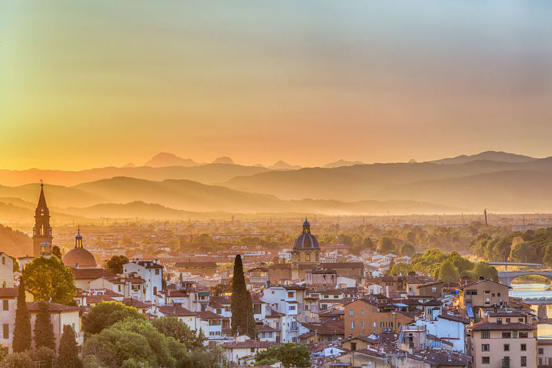 City of Florence at sunset with mountains in the mist City Cityscape Romantic Skyline Aerial View Architecture Building Exterior Built Structure City Cityscape Dawn Famous Place Florence Fog Foggy Landscape Mist Mountain Sky Summer Sunset Town Travel Travel Destinations Viewpoint