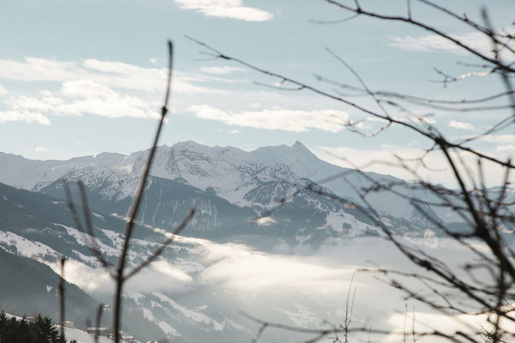 Idyllic Shot Of Snowcapped Mountains Against Sky