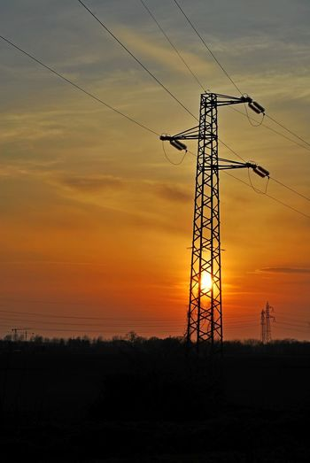 Cable Chiaravalle, Milano Cloud - Sky Connection Day Electricity  Electricity Pylon Fuel And Power Generation Landscape Low Angle View Nature No People Orange Color Outdoors Power Line  Power Supply Scenics Silhouette Sky Sunset Technology Tree