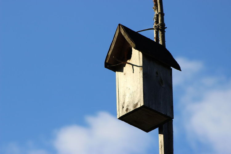 Close-Up Of Birdhouse Against Sky