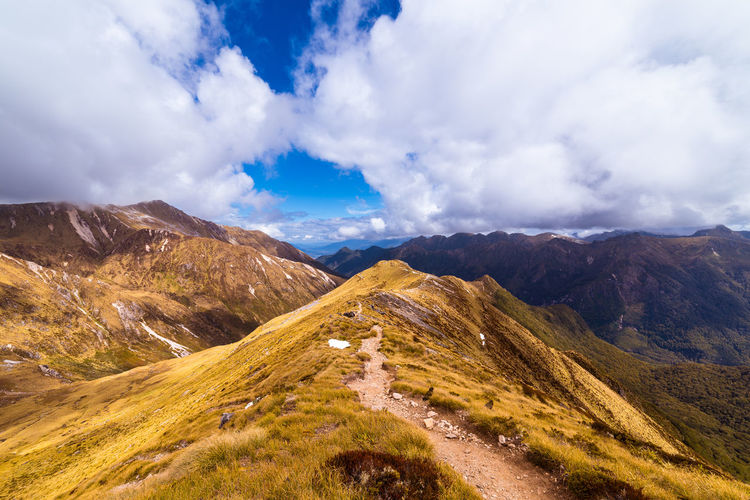 Track on top of the ridge on the Kepler track Cloudy Hiking Nature Path Tranquility Travel Trekking Beauty In Nature Colorful Day Hiking Trail Landscape Mountain Mountain Range Nature New Zealand No People Outdoors Pathway Ridge Scenics Sky Track Travel Destinations
