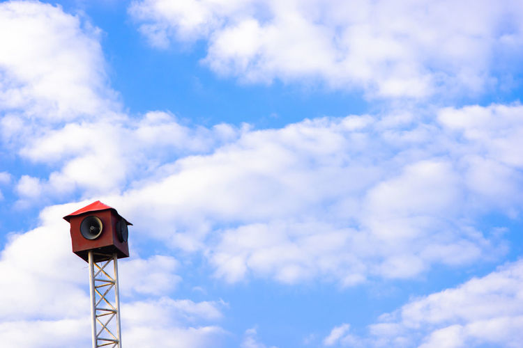 Low angle view of megaphone against blue sky
